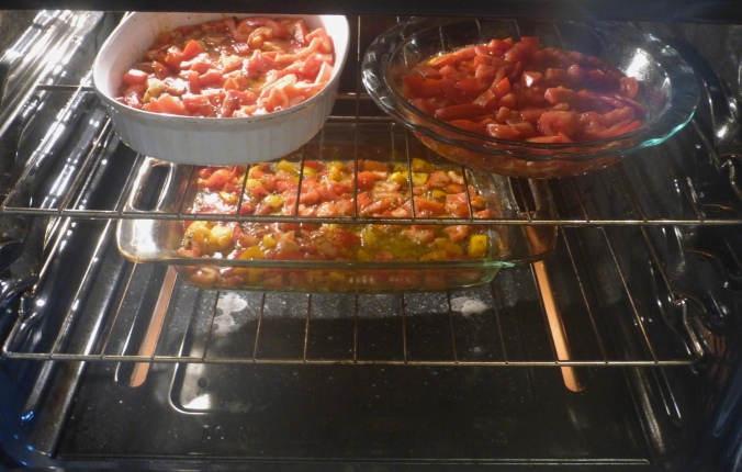 3 pans of tomatoes in the oven.