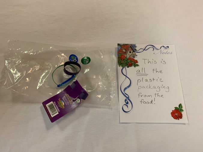 """A 5""""x8"""" clear plastic bag, 2 produce stickers, 2 rubber bands, a plastic tear-off sealing strip, and a broccoli tag"""
