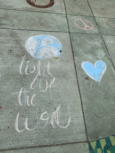 "sidewalk chalk ""light up the world,"" globe, and heart"