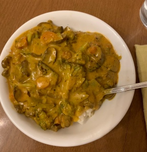 bowl of Simply Balanced Yellow Curry Simmer Sauce, vegetables, lentils, and rice