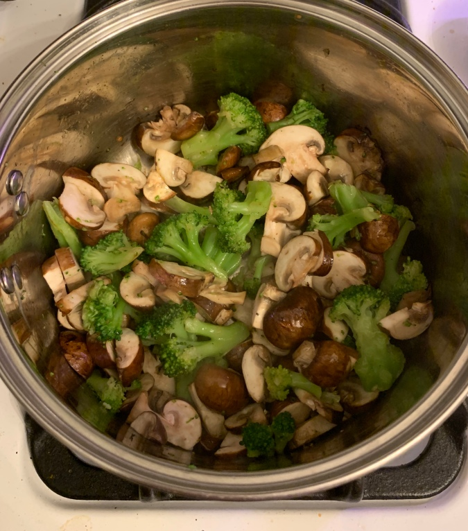 mushrooms and broccoli in a saucepan