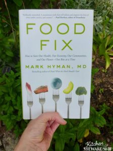 the book Food Fix, in a garden